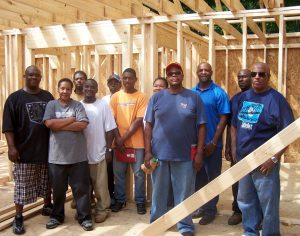 Trainees learning the craft of homebuilding